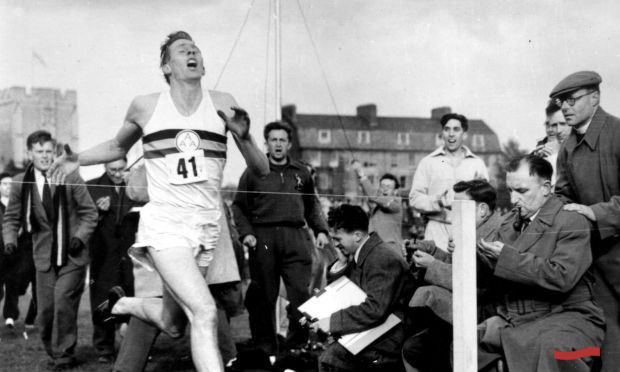 Roger Bannister at the finish line.