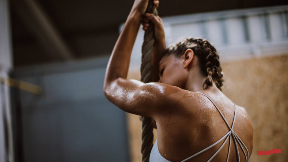 Woman sweating from gym workout