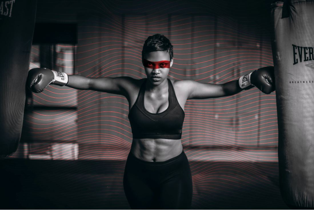 Photo of woman wearing boxing gloves