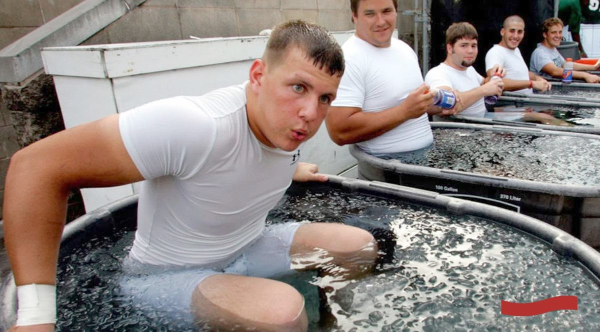 Men sitting in tubs of ice water