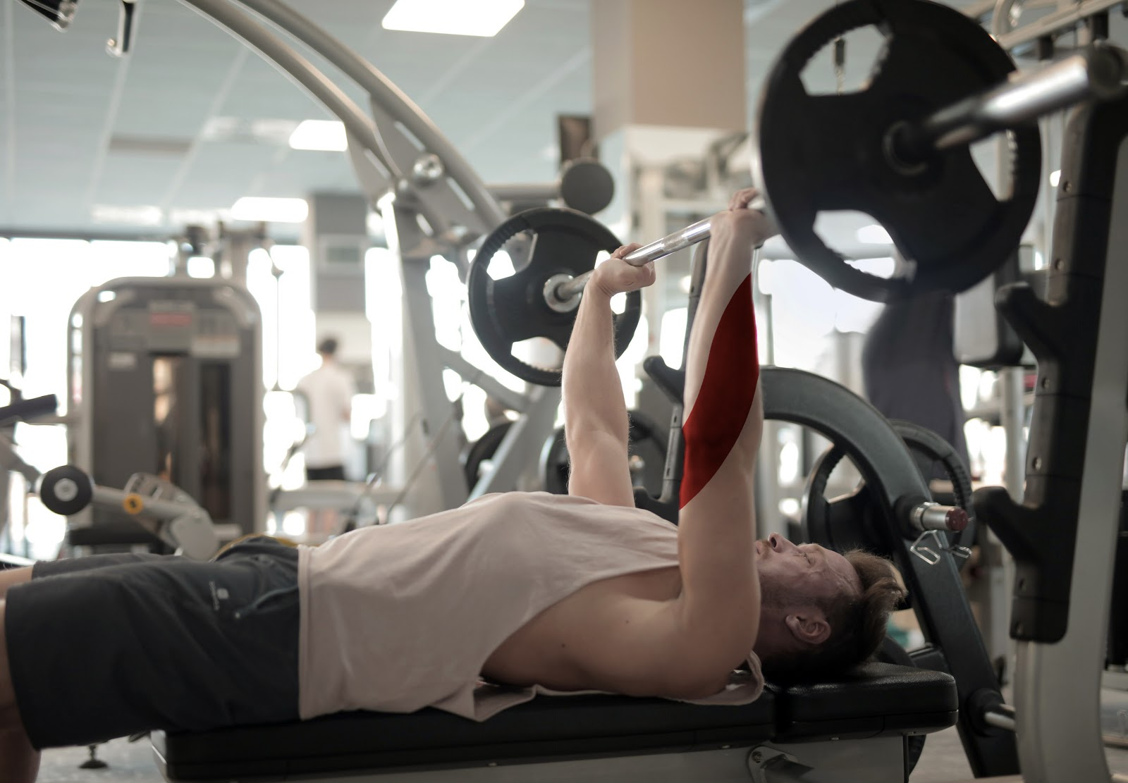 A picture of man doing bench press