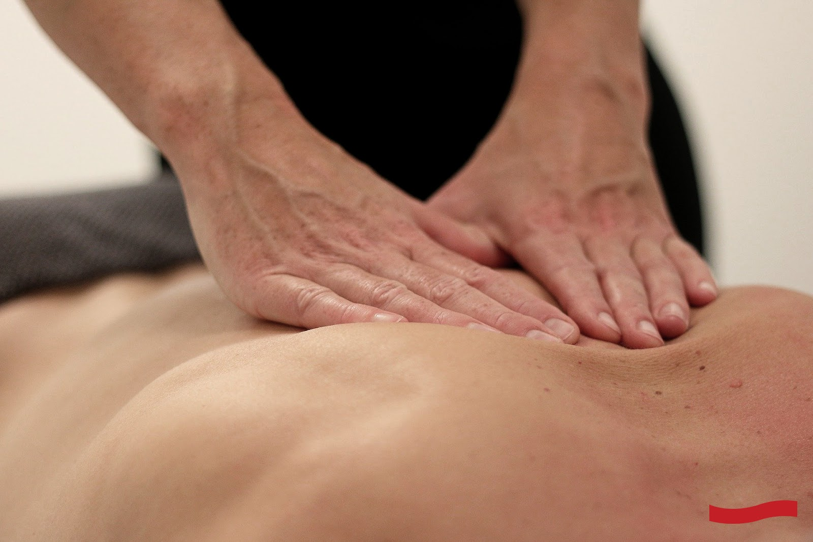 person getting back massage