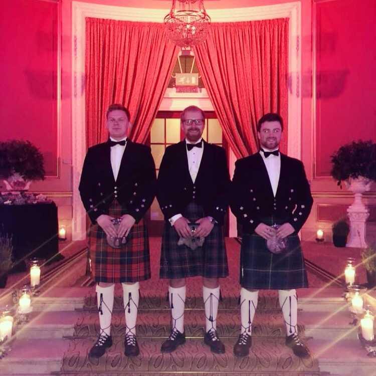 Cameron on the far right, in his traditional Scottish attire!