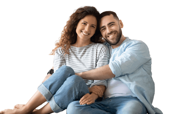 Couple who sold their house fast for cash smiling at camera