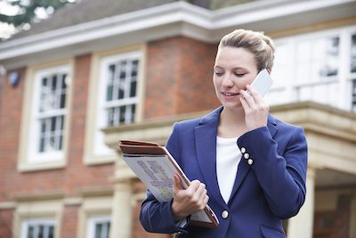 How It Works step 1. Estate agent on phone outside property.