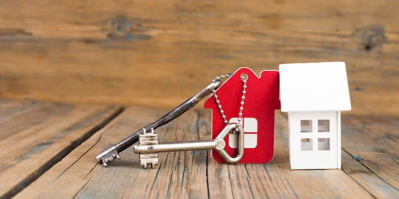 Image of a red model house on a key ring to signfiy Negative Equity: What is it, and how to sell your house in negative equity