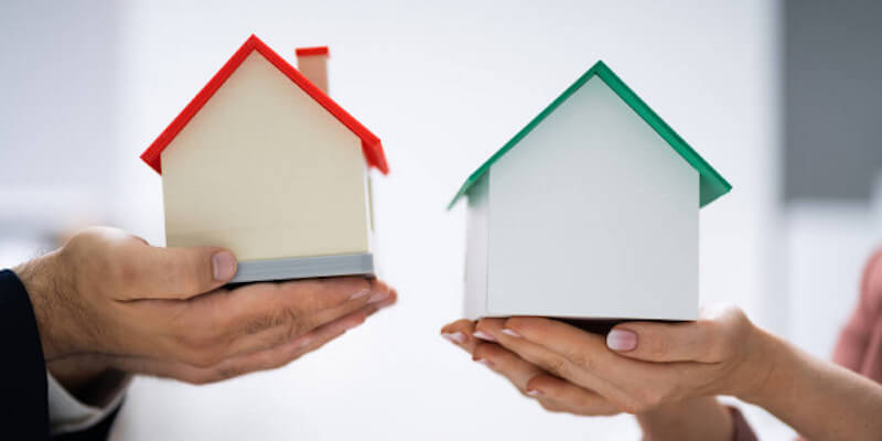 People exchange model houses to demonstrate part exchanging your house