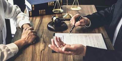 Inheritance, Probate and Wills: Man sits with lawyer to discuss inheritance