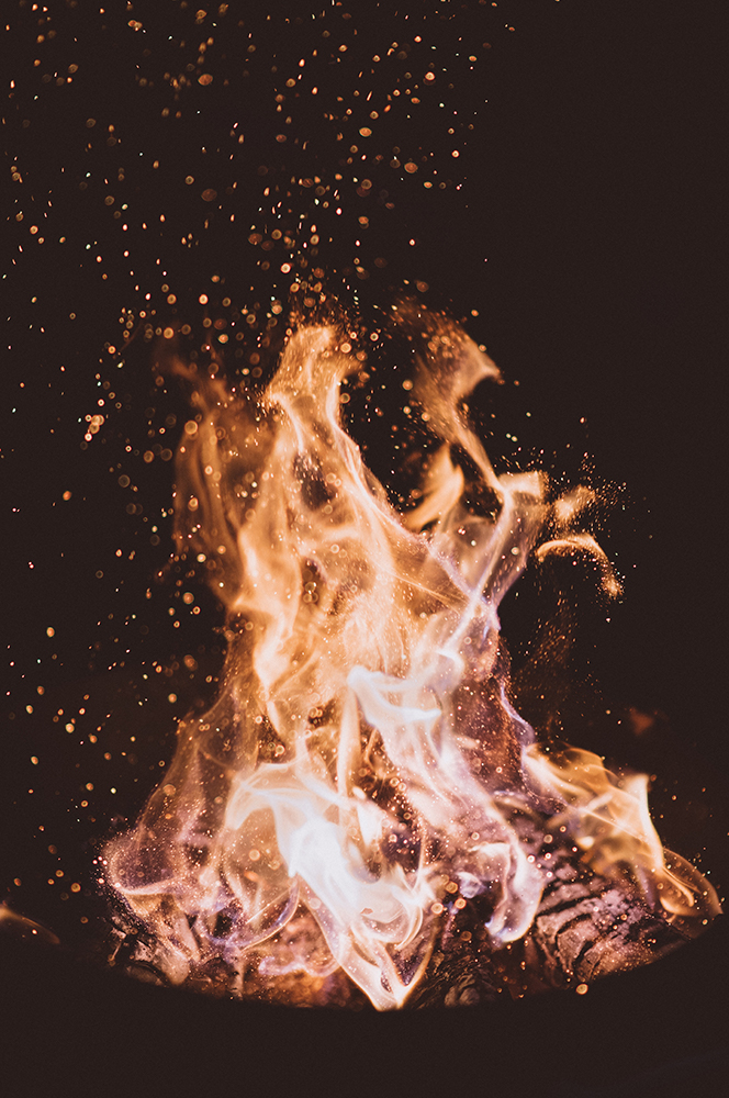 Close up photo of fire at night by Joshua Newton