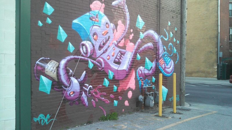 Why this is awesome: I saw this mural in Fountain Square after reading and chilling inside the Funkyard coffeehouse ....