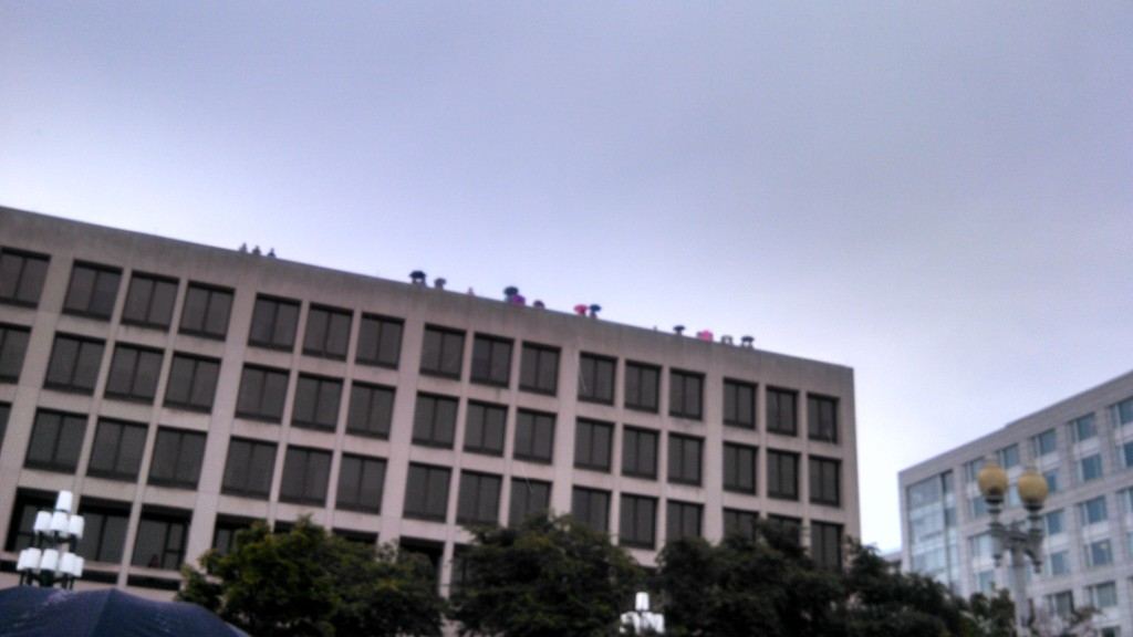 Workers looking down from Dept of Labor