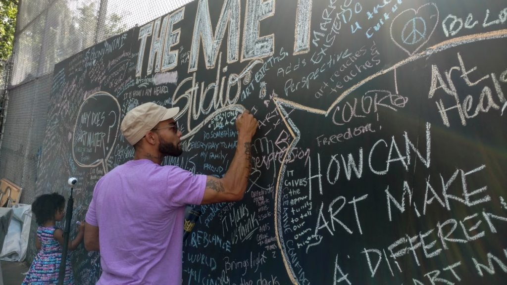 Brother signing the Met Chalk Mural
