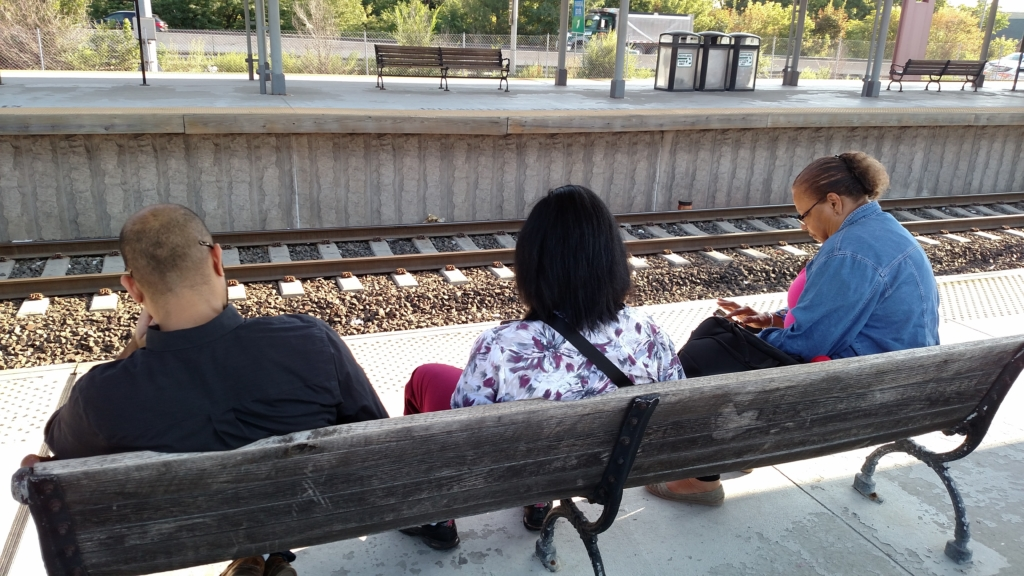 Commuters hogging a bench
