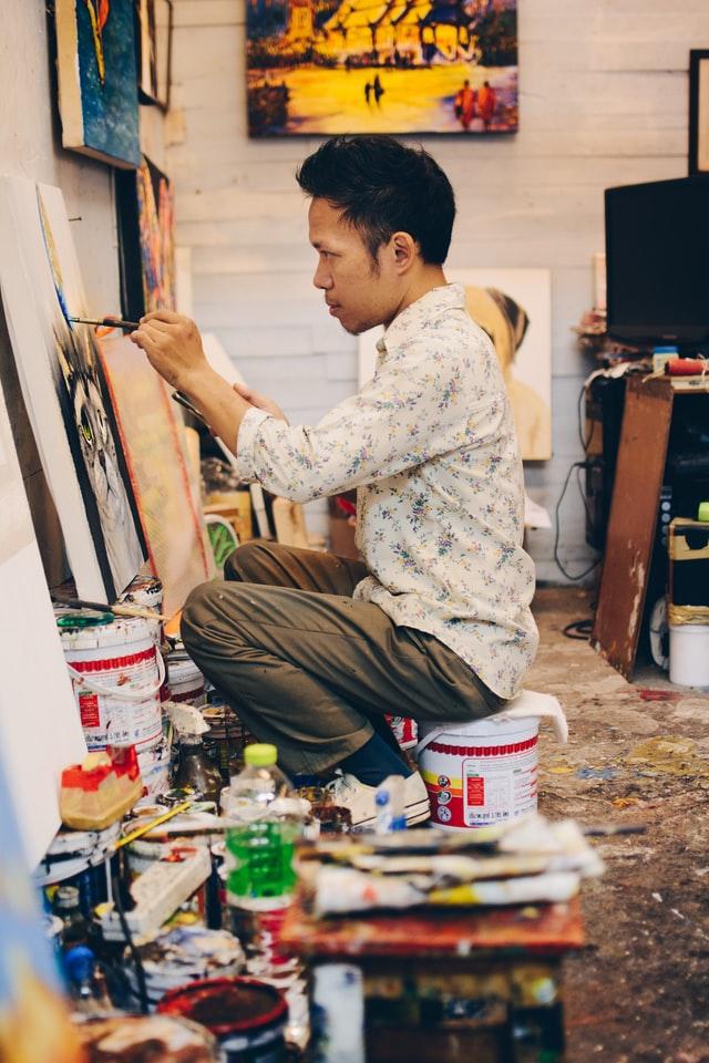 Artist in Underground Bazaar by Adli Wahid