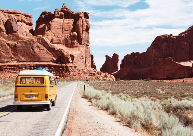 Driving Through Arches NP by Dino Reichmuth