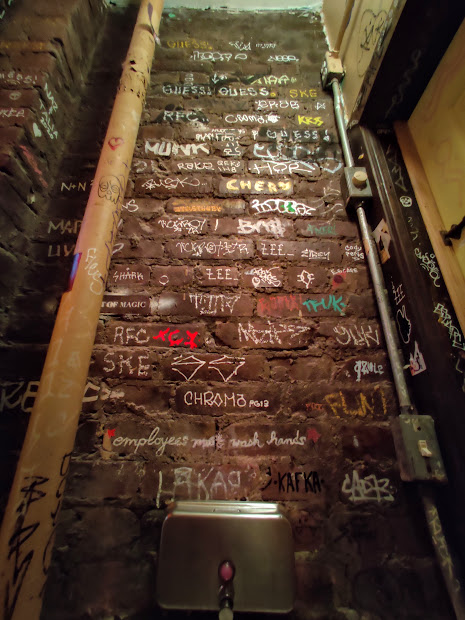 The restroom wall at MUD in NYC