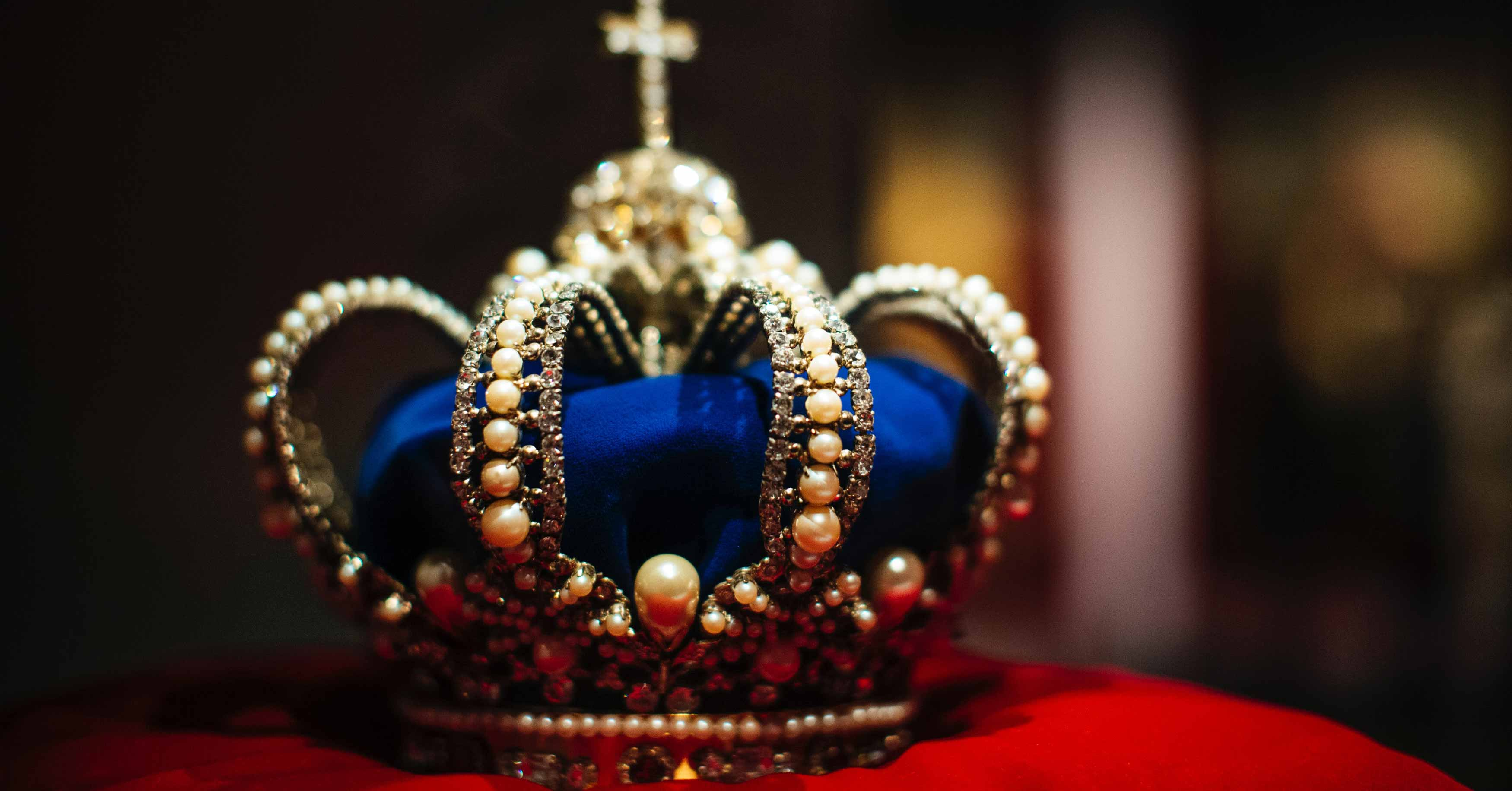 Crown on red cushion