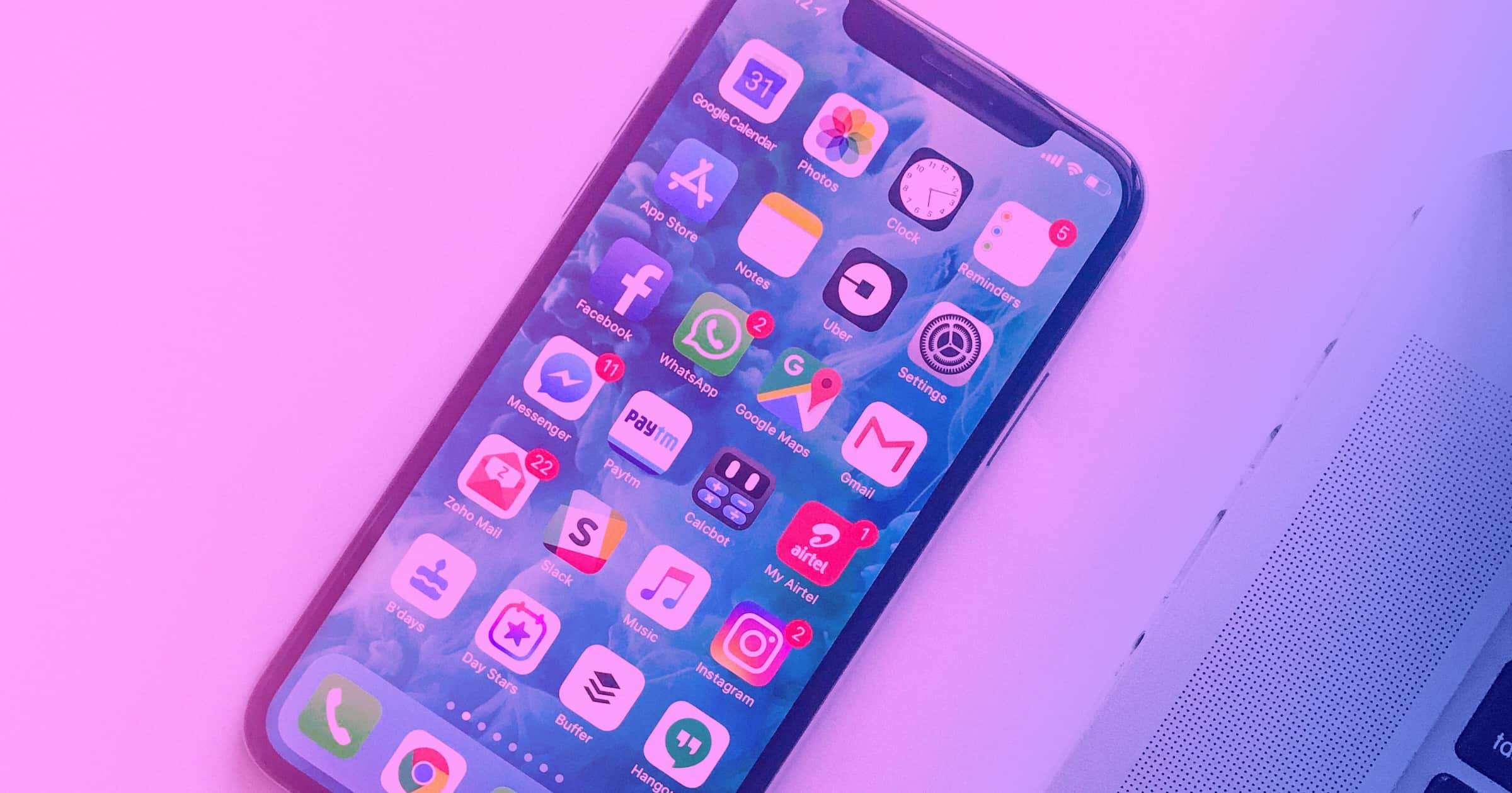 An image of a smartphone with some of the essential design apps on the iPhone's home screen