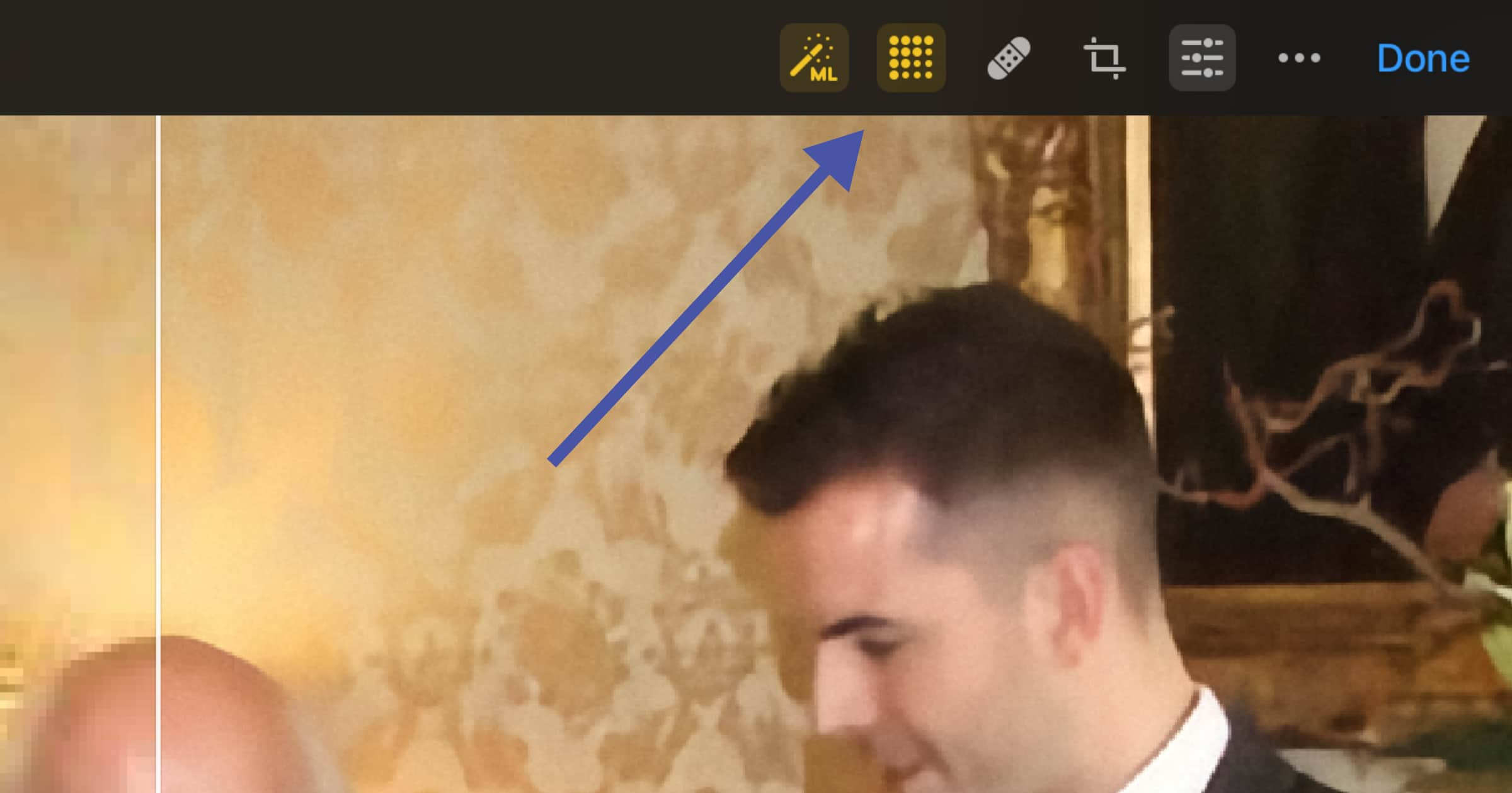 An arrow pointing to the Pixelmator ML feature to improve photo quality