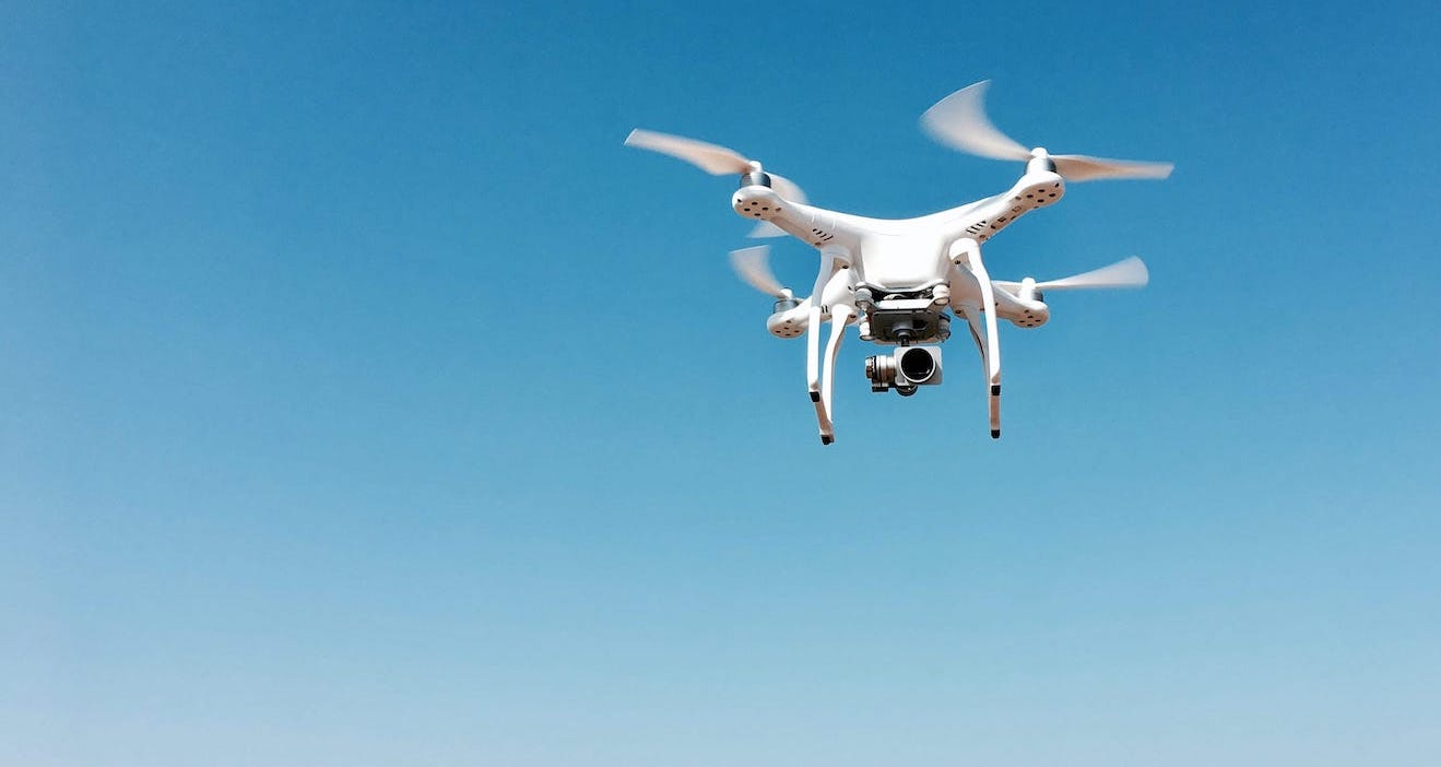 Web Competitor Analysis article cover with a drone flying in the sky