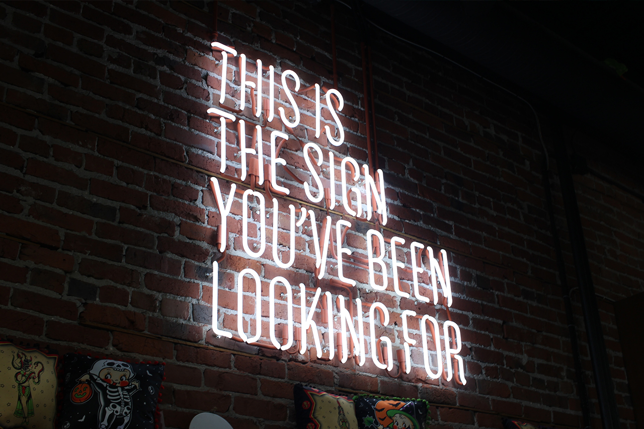 Neon sign that reads 'this is the sign you've been looking for'
