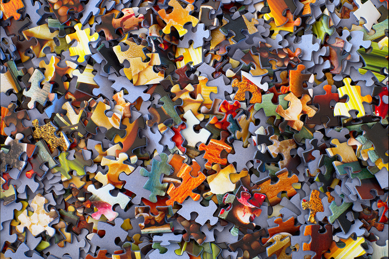 Scattered jigsaw puzzle pieces