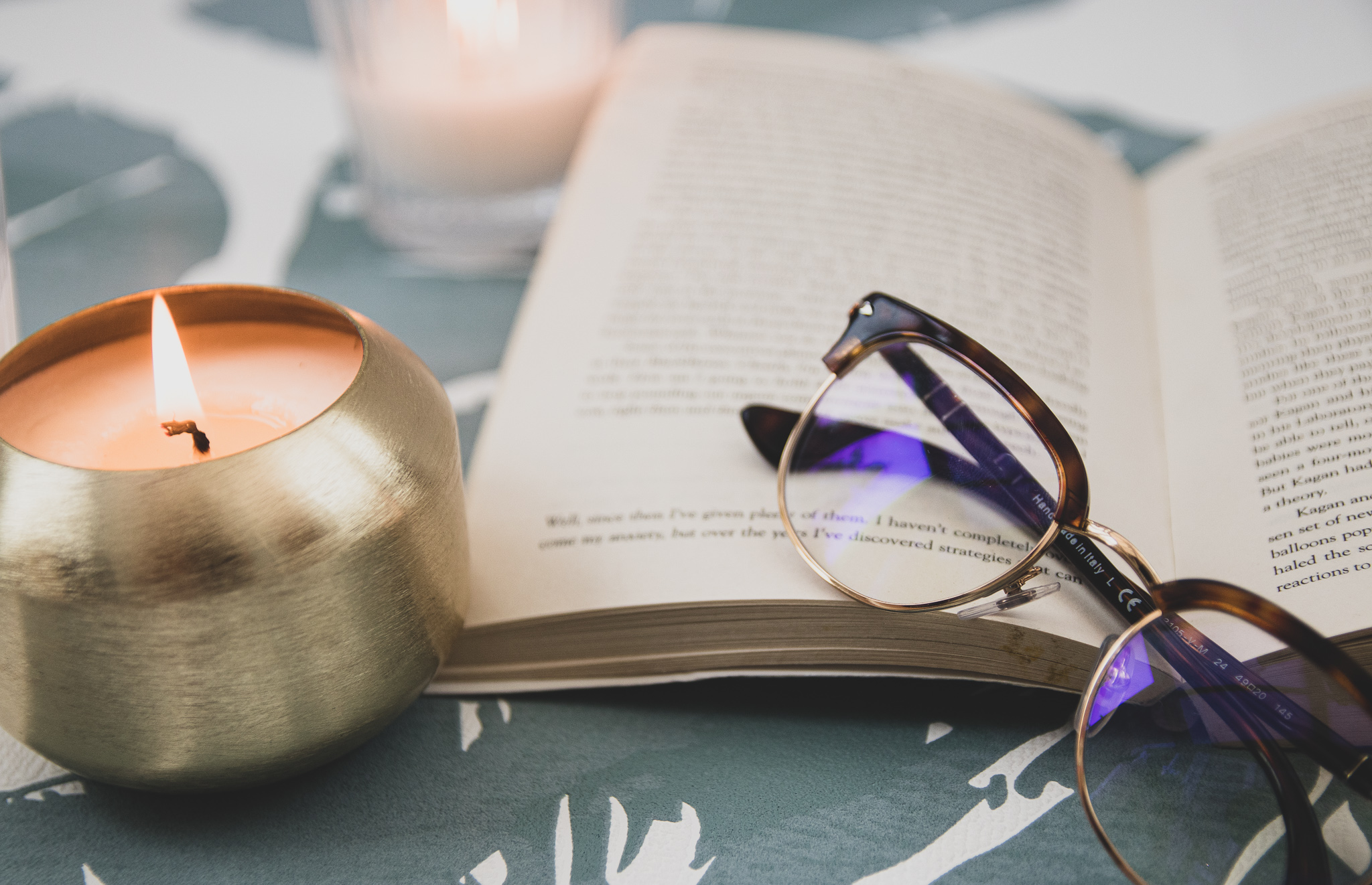 Glasses, candle and Notebook image.