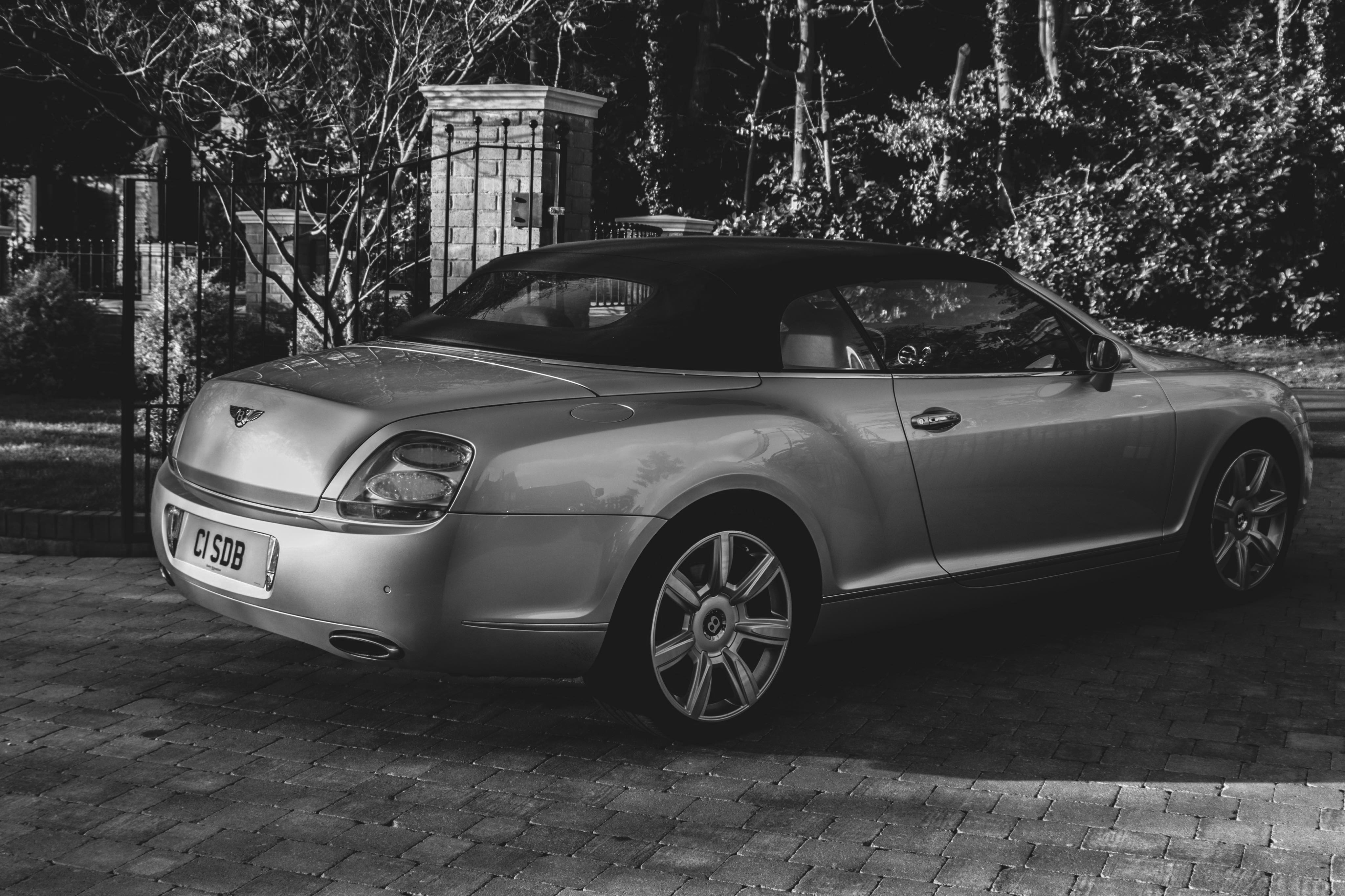 Black and white image of a Bentley GTC