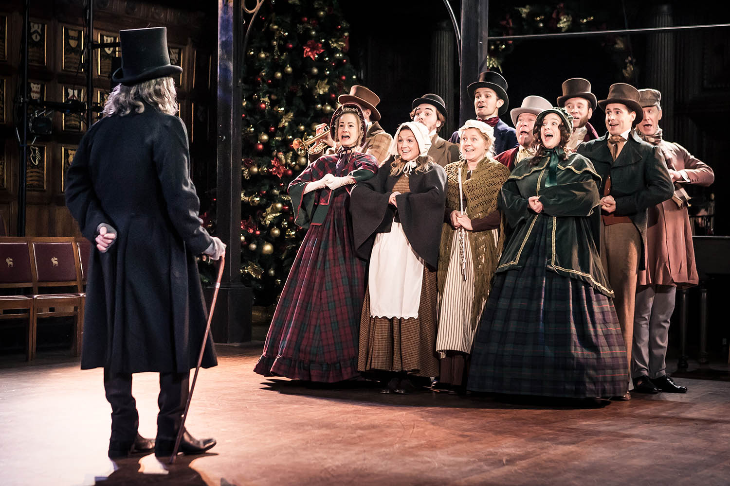 The company of Antic Disposition's A Christmas Carol, Middle Temple Hall