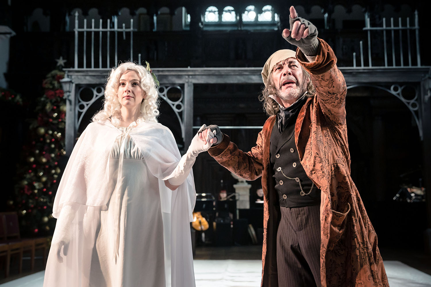 Katie Lovell and David Burt in Antic Disposition's A Christmas Carol, Middle Temple Hall