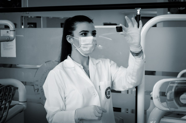 female lab tech looking at a sample