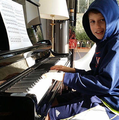 George studies piano  at Greenwich Arts Academy