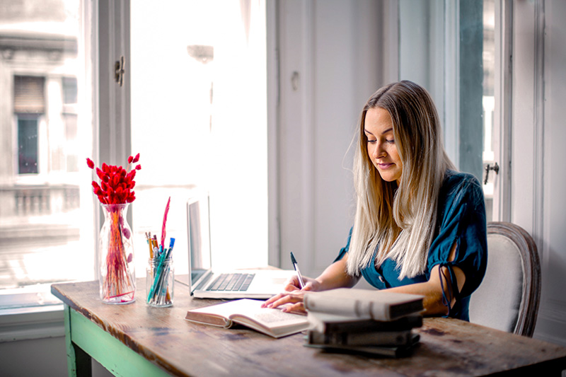 woman working from home in organized office