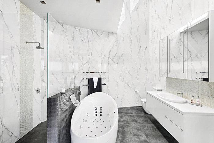 Floor to ceiling marble bathroom