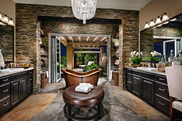 custom stone & greenery inside beautiful bathroom