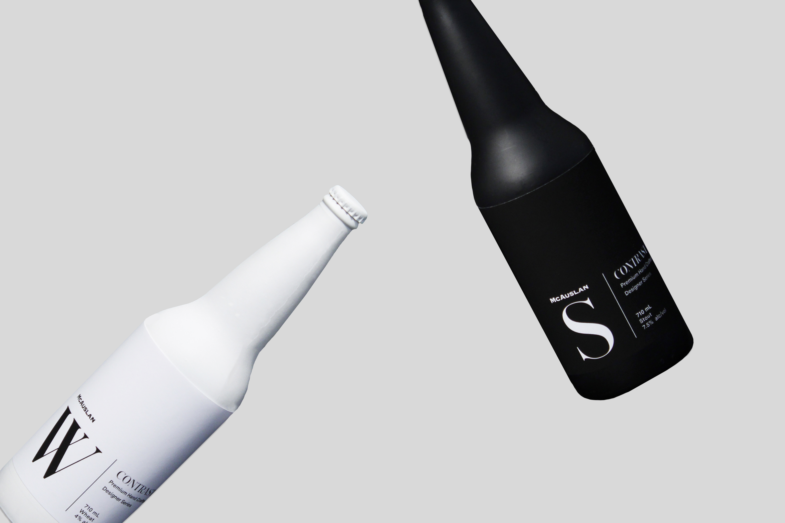 Contrast: Black and white bottle falling.