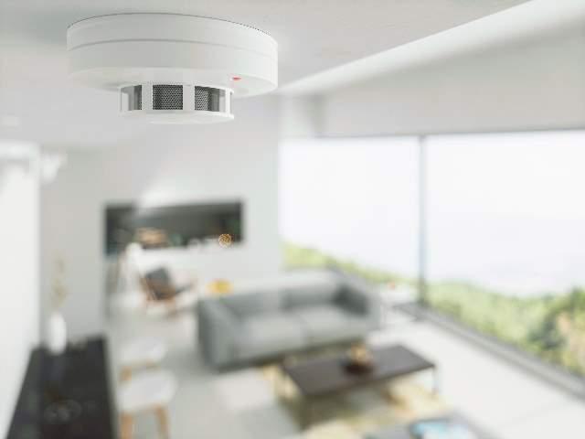 White smoke detector on ceiling