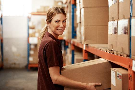 Woman holding a box in a warehouse