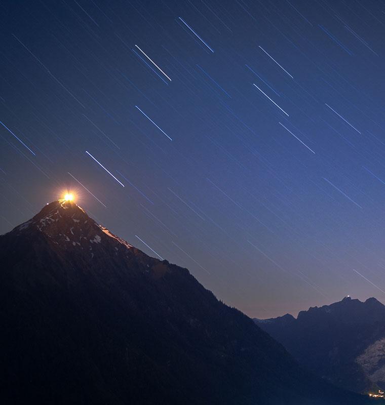 mountain with night sky