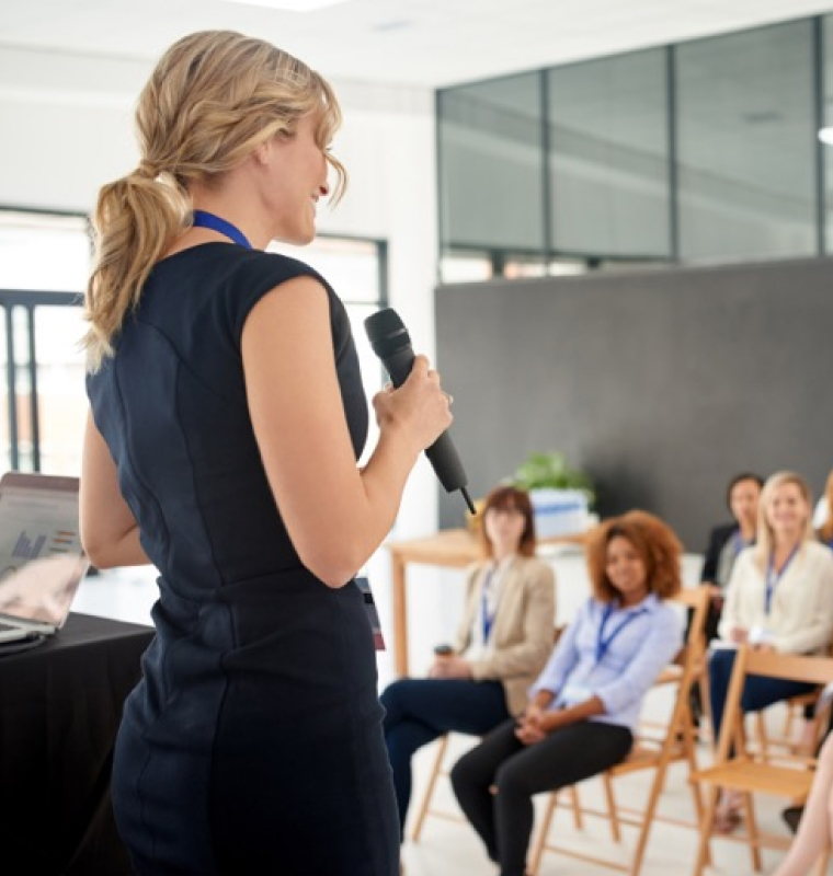 woman presenting to group at work