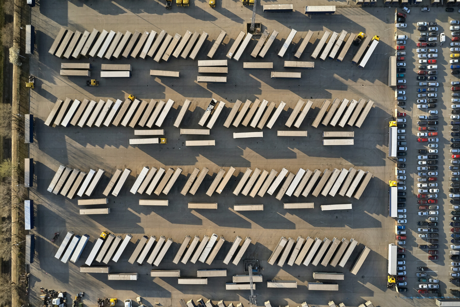 Image of a top down view of a massive logistics operation that can use the help of an intelligent yard management software system