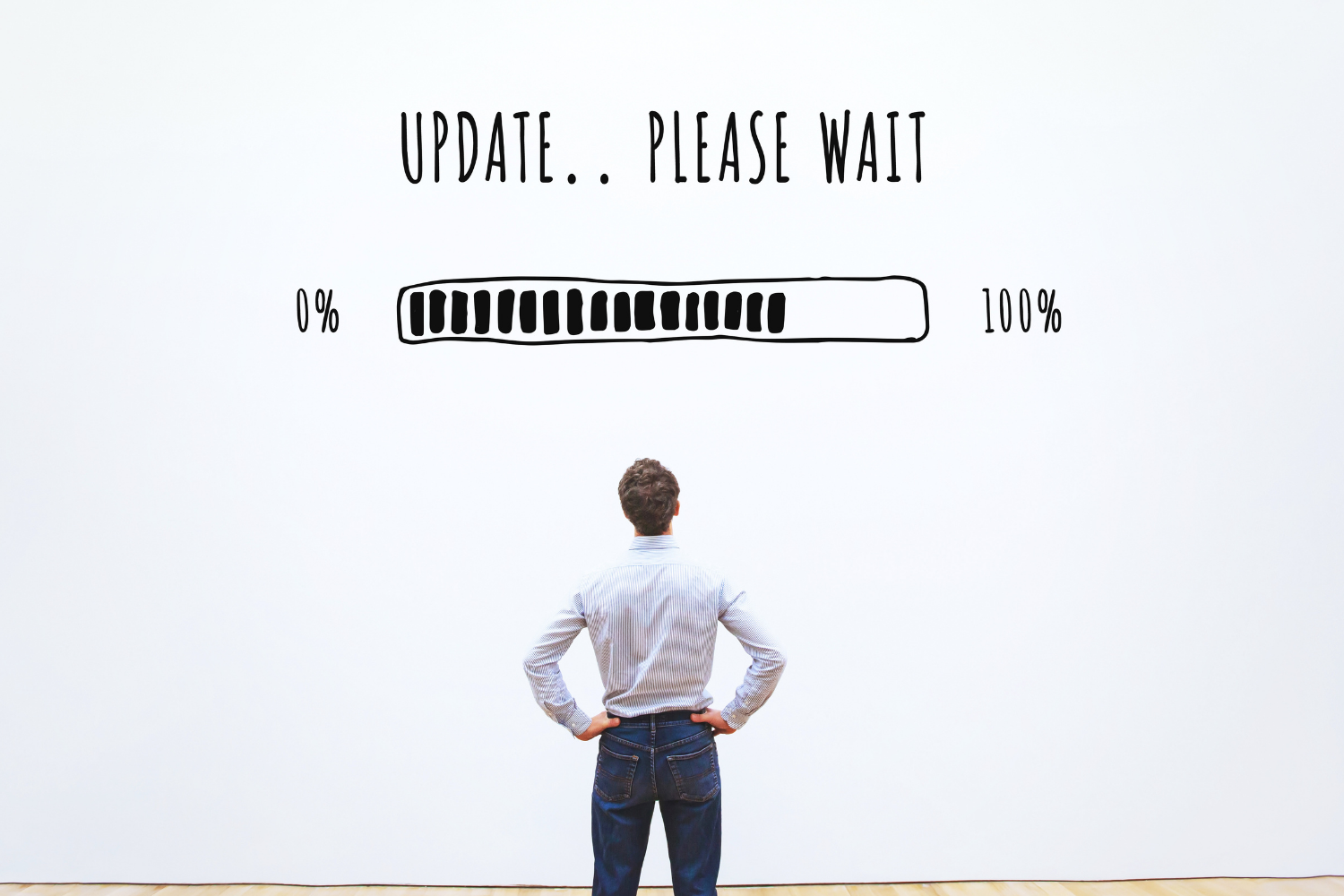 Image of man standing infront of a large screen waiting for software to download