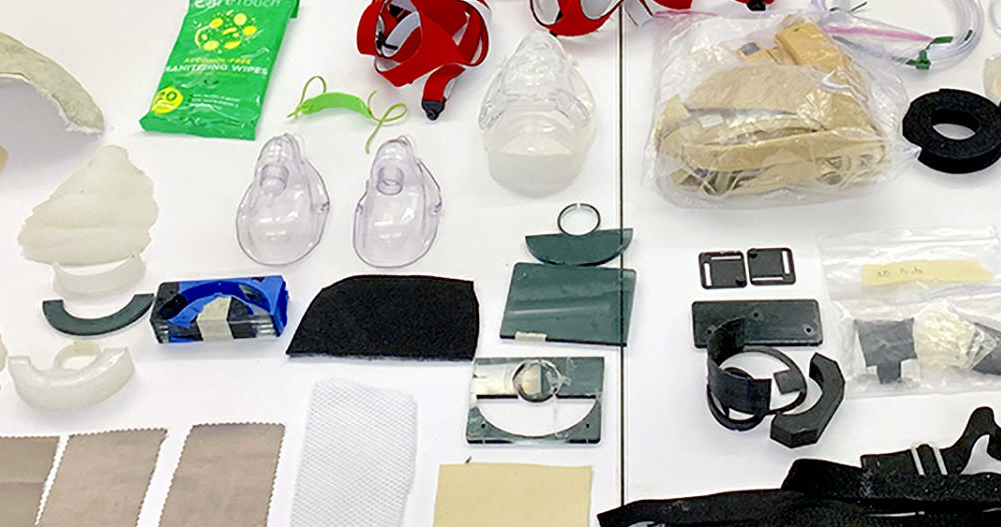 On a table lays various tools and equipment for adapting a C-Pap mask.