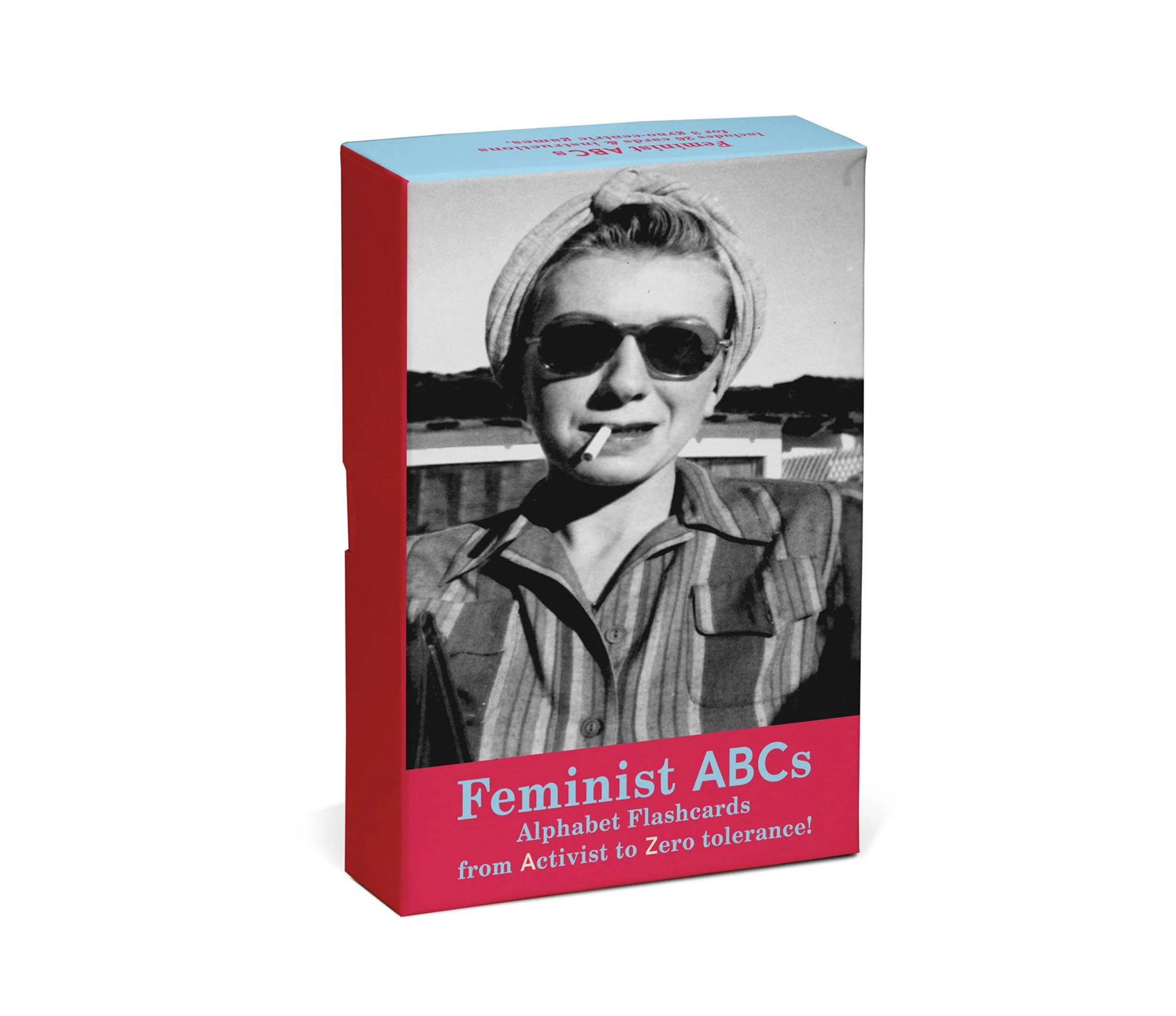 On an angle the Feminist ABC box is displayed. The box features a woman in a black and white photograph from the 1950s with a cigarette in her mouth.