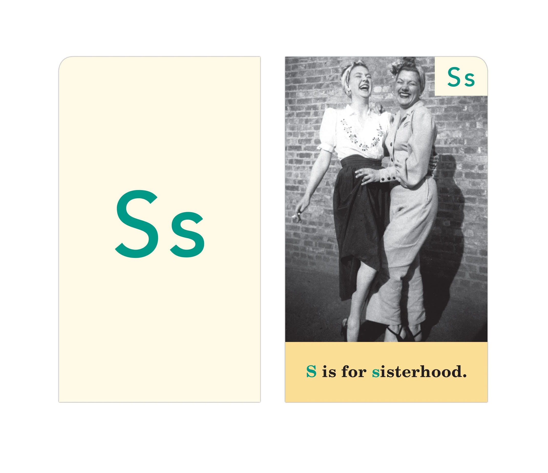 The letter card S stands for sisterhood. The front of the card is a cream color paper with the letter S on it in green. The back of the card features an image of two women laughing while holding another.