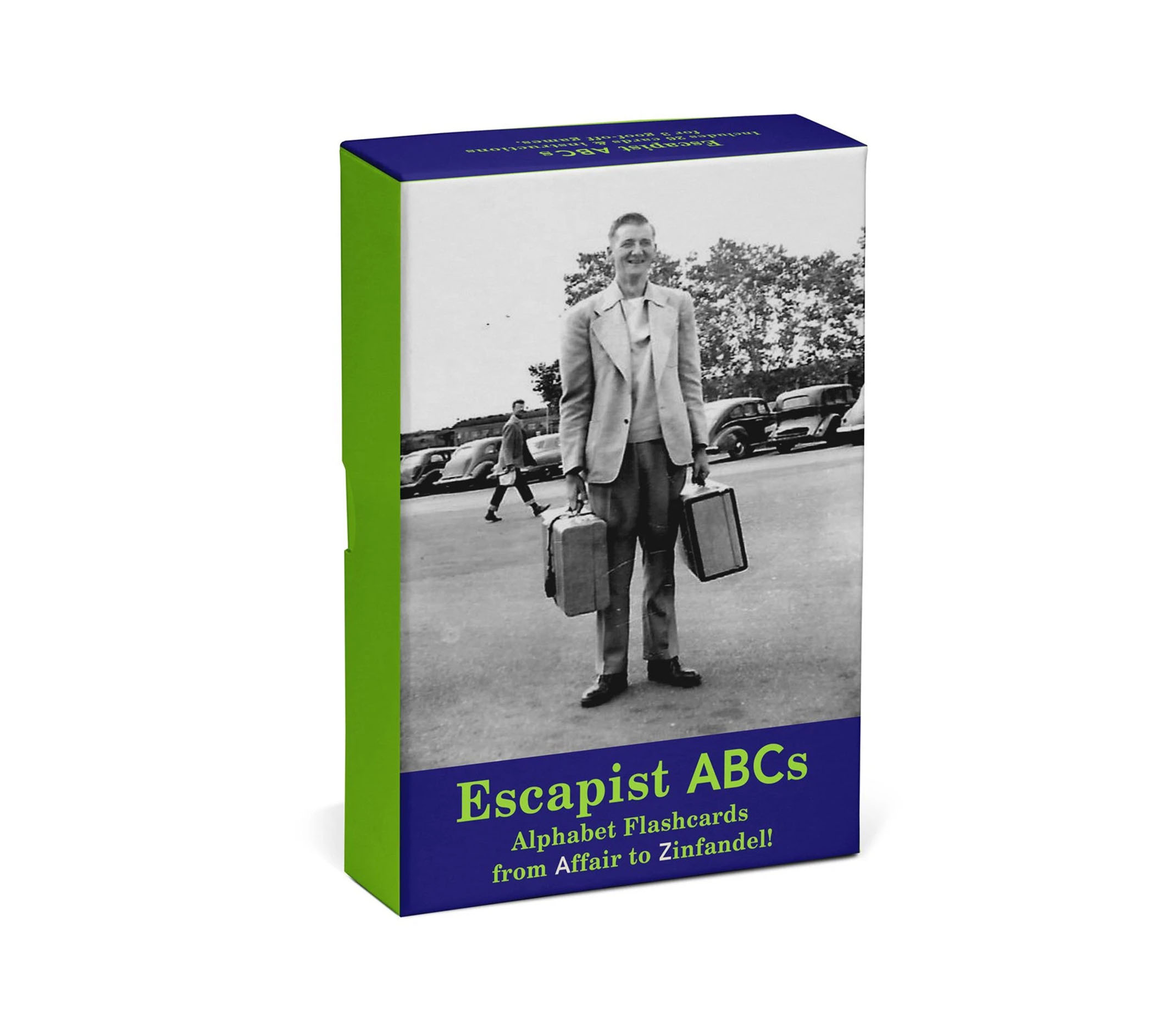 On an angle the Escapist ABC box is displayed. The box features a man in a black and white photograph from the 1950s with a a travel bag on each hand smiling.