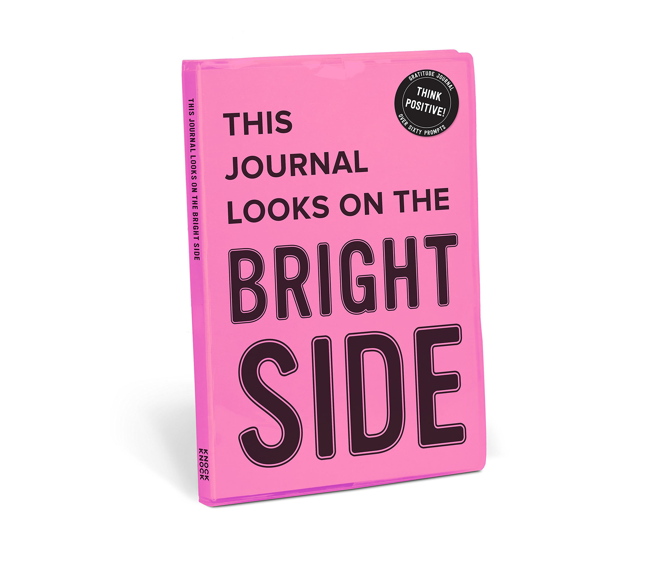 "A light pink journal titled,""This Journal looks on the bright side""."