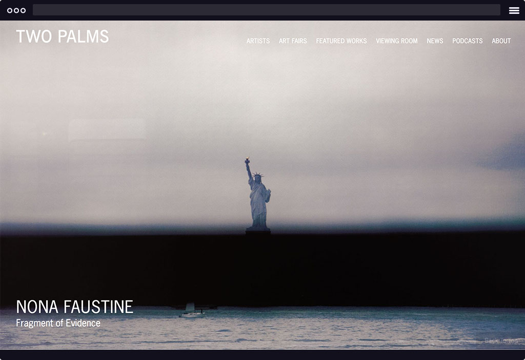This is a screenshot of Two Palms' website homepage. The page features a large image of the Statue of Liberty  in the sea with moody colors.