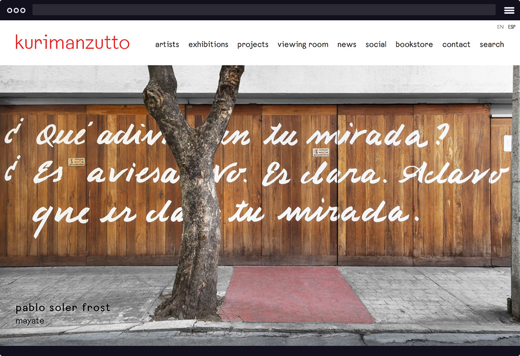 This is a screenshot of  Kurimanzutto's website homepage. The page features a large image with Spanish writing on a wooden wall outside. The image is representative of their current exhibition.