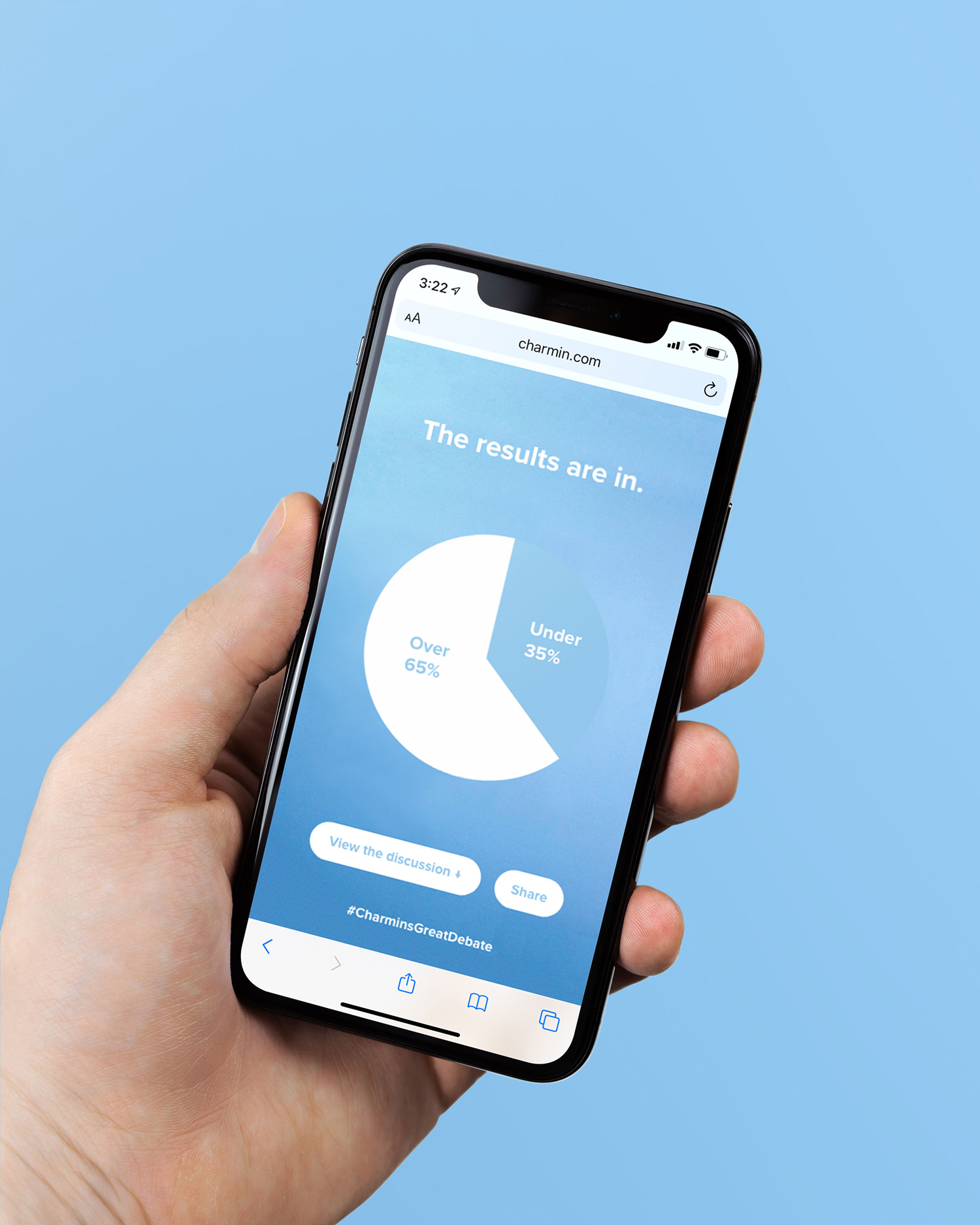 A hand holding a phone that shows the results of Charmin's Great Debate poll, on a blue background